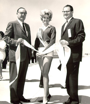 Governor Edmund G. Brown with Miss Santa Monica Freeway, 1962
