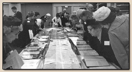 Viewing the Women in the West exhibit at the Friends' annual meeting.  Photograph, 5 May 1963.