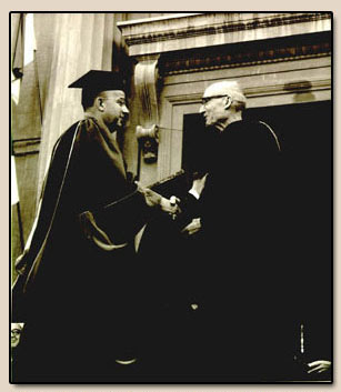 George P. Hammond receiving honorary LL.D. degree, from University of California President Clark Kerr, Photograph 1966.