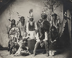 Unidentified Indians with white children, photographer unknown