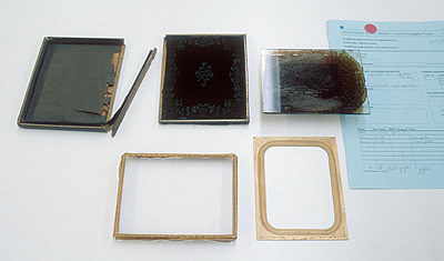 Ambrotype plate removed from its case, case cover and rail are detached