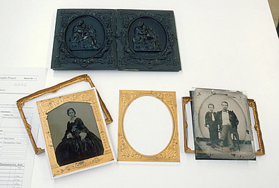 Double-sided case with two ambrotype plates, thermoplastic union case exterior is displayed, open