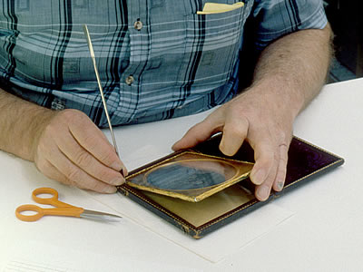 Removal of daguerreotype image package from case