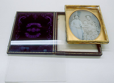 Daguerreotype in mat with brass preserver removed