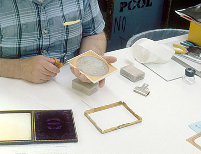New seal around daguerreotype image package being trimmed