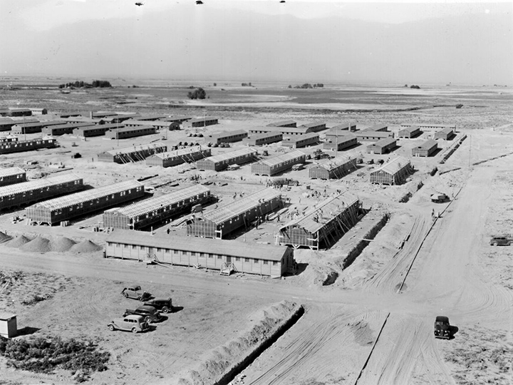 Eden, Idaho--A panorama view of the Minidoka War Relocation Authority center. This view, taken from the top of the water tower at the east end of the center, shows partially completed barracks. Photographer: Stewart, Francis--Hunt, Idaho. 8/18/42