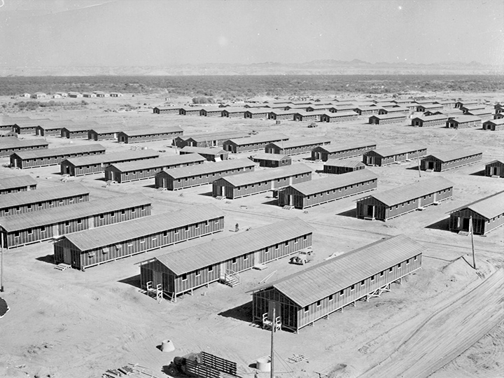 Living quarters of evacuees of Japanese ancestry at this War Relocation Authority center, as seen from the top water tower facing southwest. Photographer: Clark, Fred--Poston, Arizona. 6/1/42