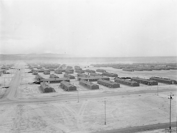 A panorama view of the Central Utah Relocation Center, taken from the water tower.  Photographer: Stewart, Francis--Topaz, Utah. 3/14/43